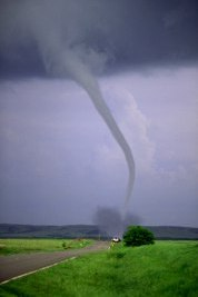a definition of a tornado a violently rotating column A tornado is a violently rotating column of air, in contact with the ground, either pendant from a cumuliform cloud or underneath a cumuliform cloud, and often ( but not always) visible as a funnel cloud the are also referred to as twisters, cyclones and whirlwinds milder forms of similar air columns over land are known as.